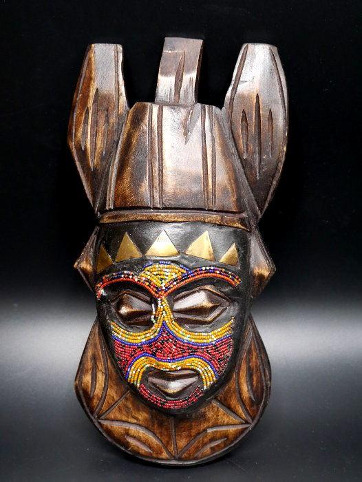 large choix de designs choisir le dernier coupe classique Masque africain kenyan